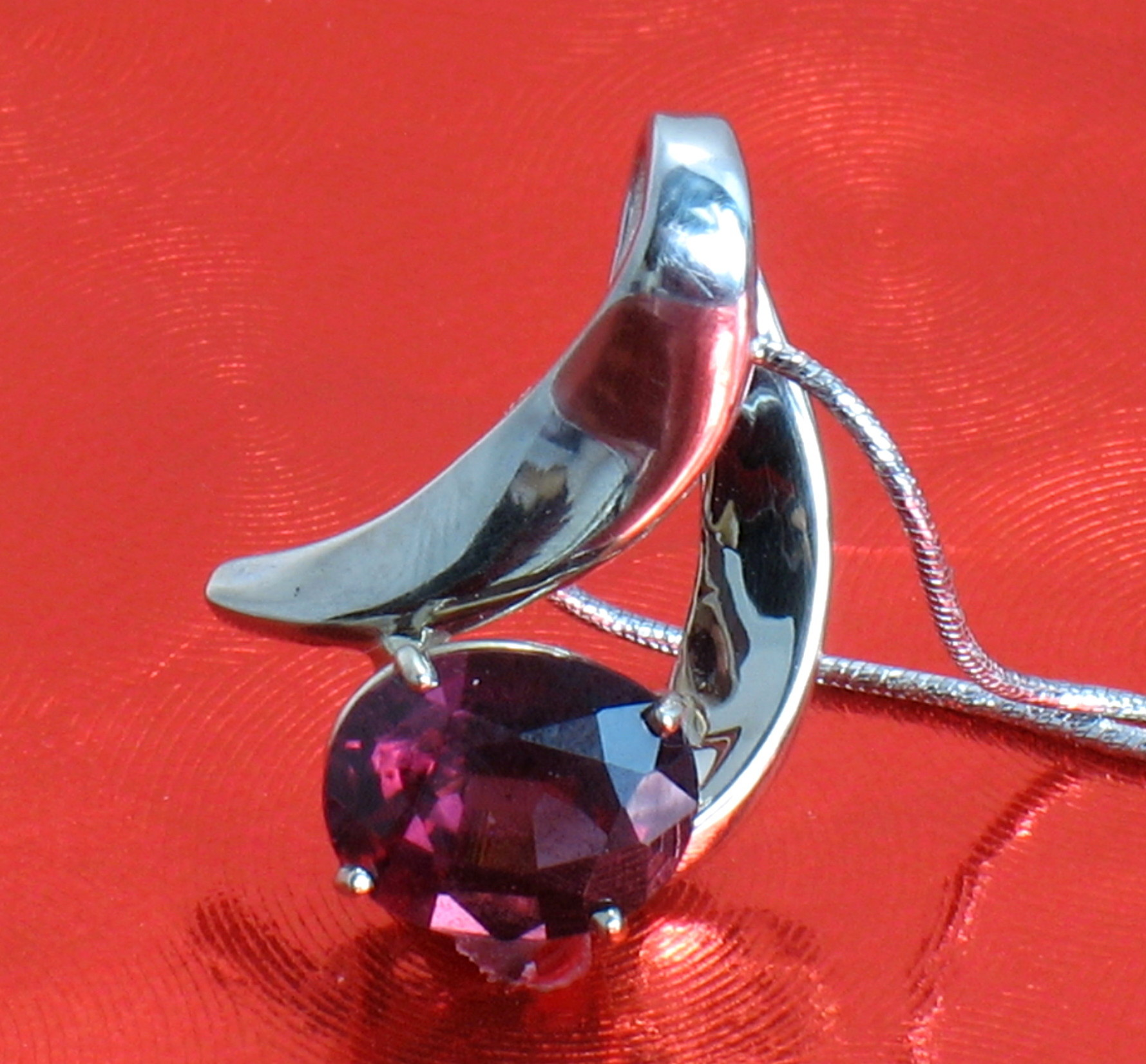 Swoop of Garnet Pendant